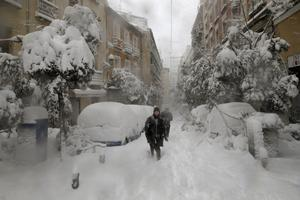 The snow left thousands trapped in cars or in train stations and airports (Andrea Comas/AP)