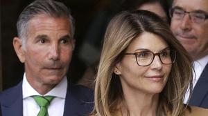 Actress Lori Loughlin, front and her husband, clothing designer Mossimo Giannulli, have pleaded guilty (Steven Senne/AP)