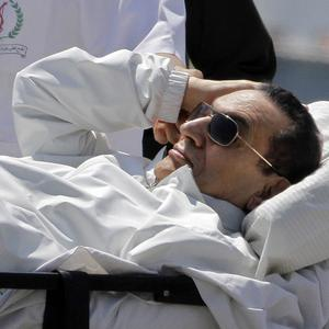 Hosni Mubarak is wheeled from a helicopter back to hospital in Cairo following his appearance in court (AP)