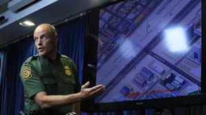 US Customs and Border Protection acting deputy commissioner Ronald Vitiello shows a concept illustration of an enforcement zone of the US-Mexico border (AP)