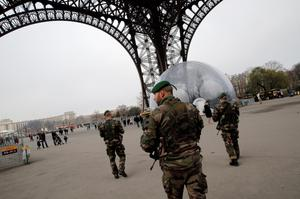 Soldiers patrol the Eiffel Tower