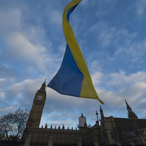 A Ukrainian national flag outside Parliament in London during a protest in memory of killed anti-government protesters in Kiev (AP)