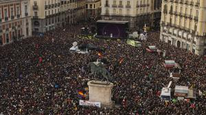 Podemos leader Pablo Iglesias speaks from the stage, as people gather in Madrid during a Podemos (We Can) party march