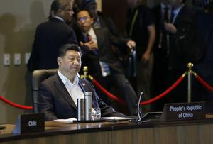 Chinese President Xi Jinping says the world is facing a choice between co-operation and confrontation (AP Photo/Aaron Favila)