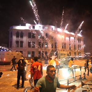 Protesters run from fireworks during clashes in Cairo, Egypt (AP)