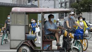 China's capital reported a slight increase in the numbers confirmed new coronavirus cases on Wednesday (Ng Han Guan/AP)