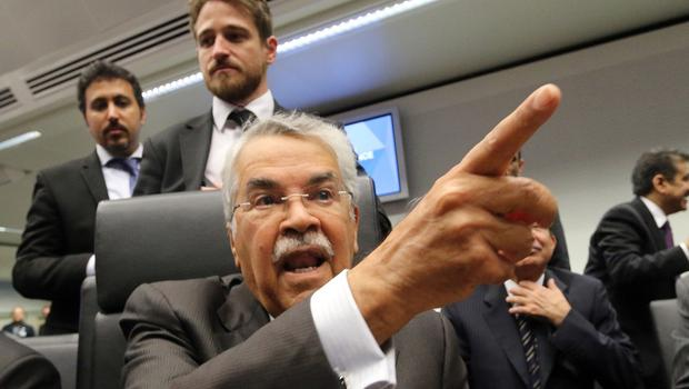 Saudi Arabia's minister of petroleum and mineral resources Ali Ibrahim Naimi speaks to journalists ahead of the Opec meeting (AP)
