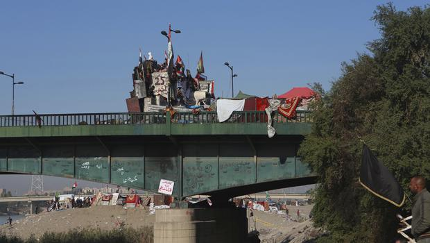 Anti-government protesters have set up camp on bridges leading to the Green Zone in Baghdad (Khalid Mohammed/AP)