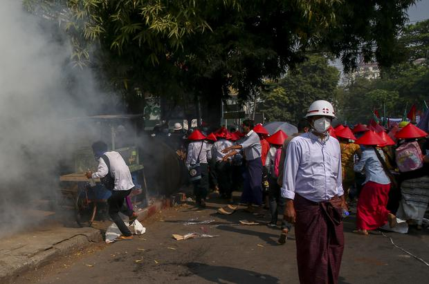 Riot police fire tear gas in Mandalay (AP)