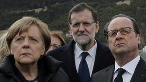 German chancellor Angela Merkel, French president Francois Hollande, right, and Spanish prime minister Mariano Rajoy pay their respects to victims near the mountain where the Germanwings jet crashed (AP)