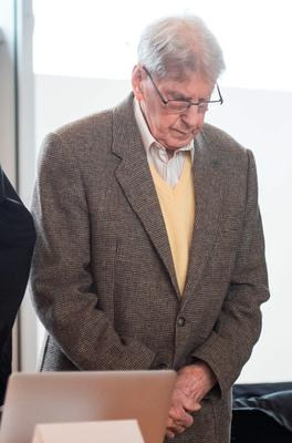 94-year-old former SS guard at the Auschwitz death camp Reinhold Hanning waits for the start of his trial in Detmold, Germany