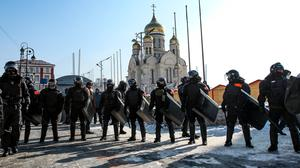 Police officers block entry to the central square in Vladivostok, Russia (Aleksander Khitrov/AP)