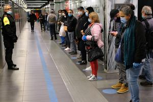 People stand apart from each other as they wait for a train in Rome (Mauro Scrobogna/LaPresse via AP)