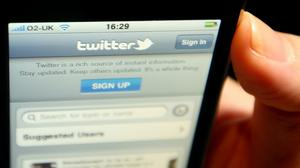 The logo of social networking website Twitter is seen displayed on the screen of an iPhone smartphone (Dominic Lipinski/PA)