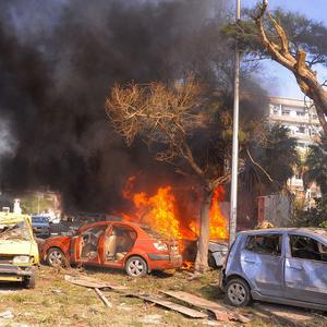 Flames and smoke rising from burned cars after a huge explosion that shook central Damascus (AP/SANA)