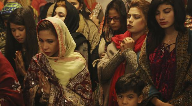 Pakistani Christians attend midnight services at St. Anthony's Church in Lahore (K.M. Chaudary/AP)
