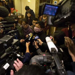 Relatives of Chinese passengers who were on missing Malaysia Airlines flight MH370 speak to journalists at a hotel in Beijing (AP)