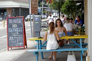 New Orleans bars have been told in increase restrictions in a bid to stem the spread of coronavirus (Gerald Herbert/AP)