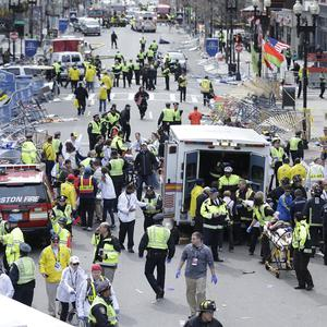 Medical workers aid injured people at the finish line of the 2013 Boston Marathon (AP)