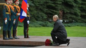 Russian President Vladimir Putin attends a laying ceremony at the Tomb of the Unknown Soldier at the Kremlin wall marking the 75th anniversary of the Nazi defeat in World War II in Moscow, Russia, Saturday, May 9, 2020. Putin cancelled a massive Victory Day marking the 75th anniversary of the Nazi defeat in World War II but ordered a flyby of warplanes over Red Square. (Alexei Druzhinin, Sputnik, Kremlin Pool Photo via AP)