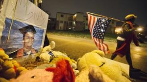 A high school graduation photo of Michael Brown stands at a memorial near the spot where he was shot dead by a white policeman in Ferguson, Missouri (AP)