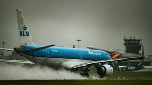 A KLM plane prepares to take off in rainy conditions at Leeds Bradford Airport (Danny Lawson/PA)