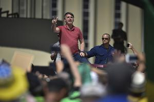 President Jair Bolsonaro speaks to supporters during a protest in front the army's headquarters in Brasilia on Sunday (Andre Borges/AP)