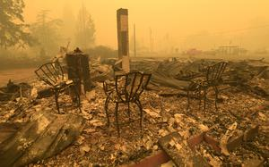 Three chairs are all that remain at the post office in Gates, Oregon (Mark Ylen/Albany Democrat-Herald/AP)