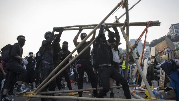 Protesters test a self-made catapult (Ng Han Guan/AP)