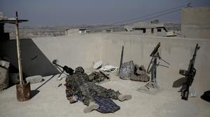 A sniper with the Iraqi federal police aims at an Islamic State position (AP/Bram Janssen)