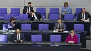 German Chancellor Angela Merkel, front right, addresses parliament (Michael Sohn/AP)