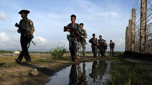 Burma armed forces patrol a border fence with Bangladesh in Maungdaw, Rakhine State (AP)