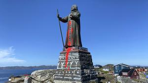 The vandalised statue of noted coloniser Hans Egede in Nuuk, Greenland (Christian Klindt Soelbeck/AP)