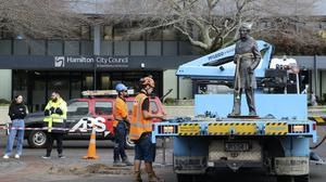 Council workers have removed the bronze statue of British Captain John Fane Charles Hamilton from a square in central Hamilton, New Zealand (Hamilton City Council/AP)