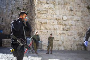 An Israeli police officer and soldiers block Jaffa gate in Jerusalem's old city (Ariel Schalit/AP)
