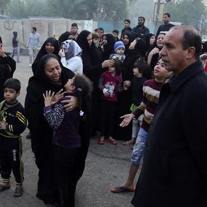 Mourners grieve for a man killed in an earlier bombing at a cafe in Baghdad. (AP)