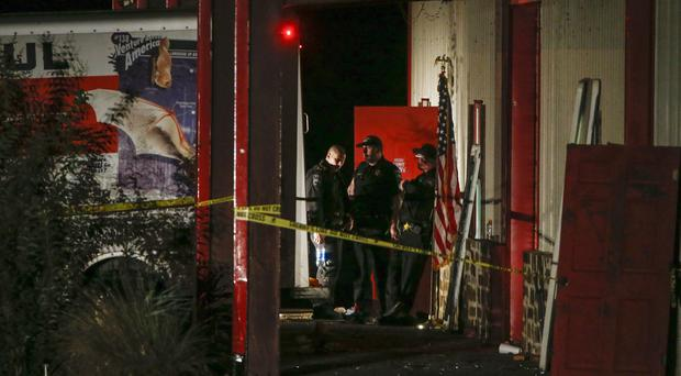 Officials at the crime scene after a shooting in Texas (Ryan Michalesko/The Dallas Morning News via AP/PA)
