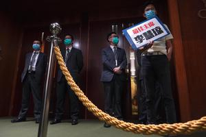 Mr Chu's ejection disrupted the start of the debate on a contentious bill that would criminalise insulting or abusing the Chinese national anthem. (Vincent Yu/AP)
