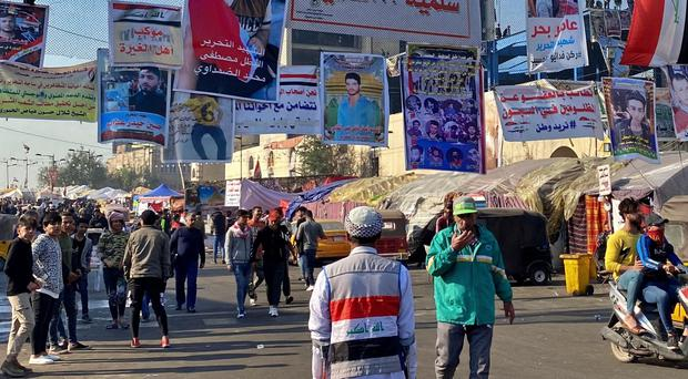 Anti-government protesters gather in Tahrir Square in Baghdad (Khalid Mohammed/AP)