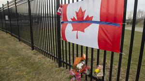 A tribute is displayed at the Royal Canadian Mounted Police headquarters in Dartmouth, Nova Scotia (Andrew Vaughan/The Canadian Press via AP)