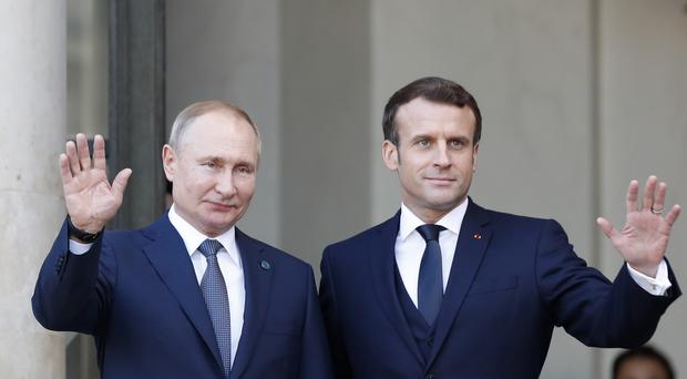 French President Emmanuel Macron, right, and Russian President Vladimir Putin (AP/Thibault Camus)