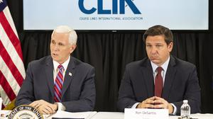 Vice President Mike Pence and Florida Governor Ron DeSantis meet with cruise line company leaders to discuss efforts to fight the spread of the coronavirus on Saturday (Gaston De Cardenas/AP)