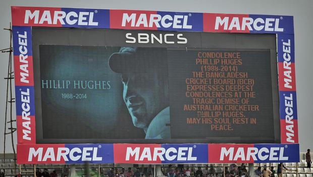 A screen shows a portrait of Phillip Hughes before the one-day match between Bangladesh and Zimbabwe in Dhaka (AP)