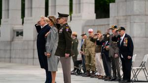 President Donald Trump and first lady Melania Trump participate in a wreath laying ceremony (Evan Vucci/AP)