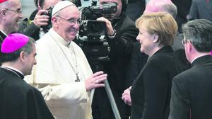 VATICAN CITY, VATICAN - MARCH 19:  Pope Francis greets German Chancellor Angela Merkel during the Inauguration Mass on March 19, 2013 in Vatican City, Vatican. The mass was held in front of an estimated crowd of up to one million pilgrims and faithful who have filled the square and the surrounding streets to see the former Cardinal of Buenos Aires officially take up his role as pontiff. Pope Francis' inauguration took place in front of Cardinals and spiritual leaders as well as heads of state from around the world.  (Photo by Guido Bergmann - Bundesregierung Pool via Getty Images)