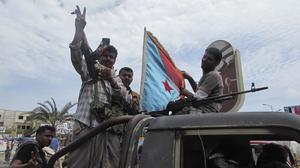 Militiamen loyal to President Abed Rabbo Mansour Hadi ride on an army vehicle in Aden (AP)