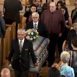 Mandy Trecartin, left behind coffin, and Andrew Barthe at the funeral for their sons Noah and Connor Barthe (AP/The Canadian Press, Andrew Vaughan)
