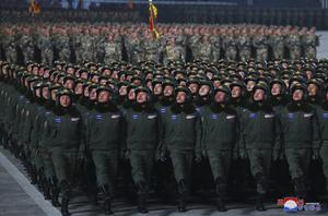 North Korean soldiers march in formation during a military parade (AP)
