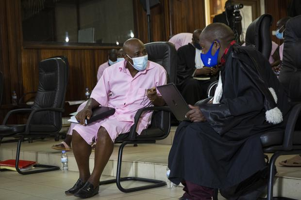 Paul Rusesabagina speaks to lawyers as he attends a court hearing in Kigali (Muhizi Olivier/AP)