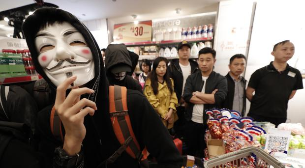 Protesters gather inside a store at a shopping centre near the border with mainland China (Lee Jin-man/AP)